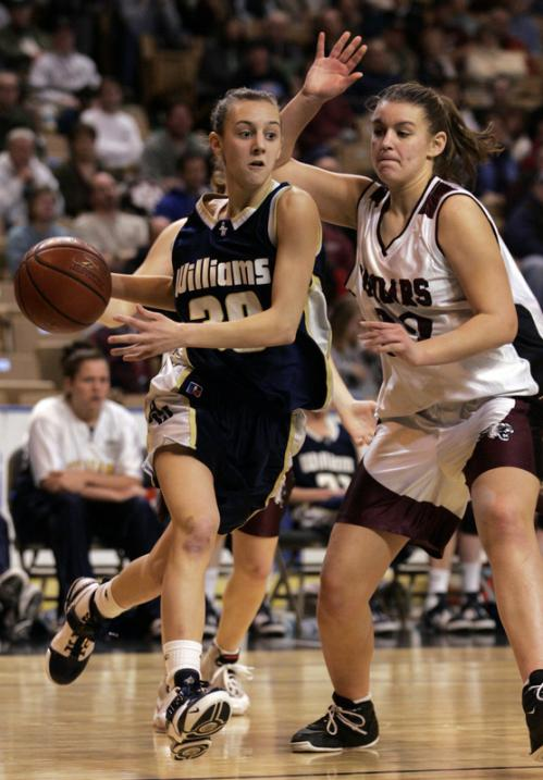 Archbishop Williams' Jill LaFond slips past Quaboag's Samantha McCann.