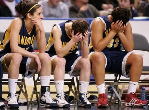 (Left to right): Andover's Alex Alois, Kelly Driscoll, and Camille Fantini react to loosing to Northampton.