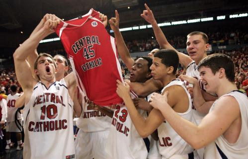Central Catholic's players lift the jersey of teammate Ryan Bourque, who was killed in a car crash on November 15.