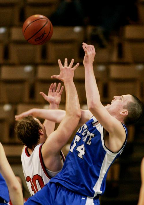 Frontier Regional's Jon Pepyne (30) and Scituate's Sean McCarthy both reach for a rebound.