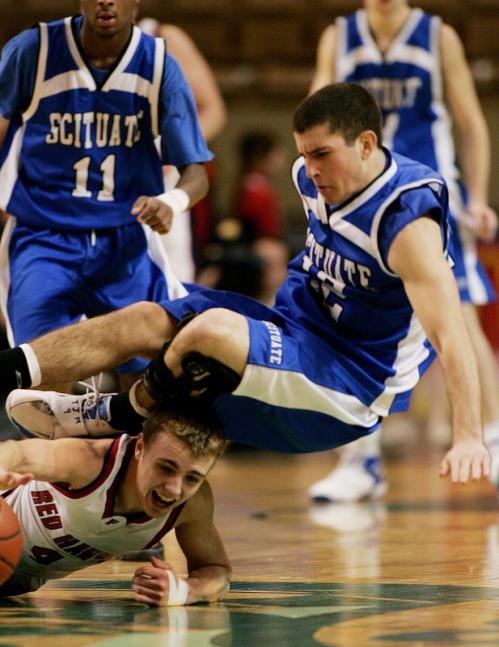 Frontier Regional's Brennan McKenna (bottom) get a hand on a loose ball as Scituate's Sam Malone (12) fall to the court.