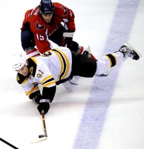 Things weren't looking up for Bruins forward Marc Savard after the Capitals' Boyd Gordon took him down.