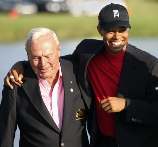 Tiger Woods sports a big smile and a new jacket after winning Arnold Palmer's tournament, his fifth straight PGA title.