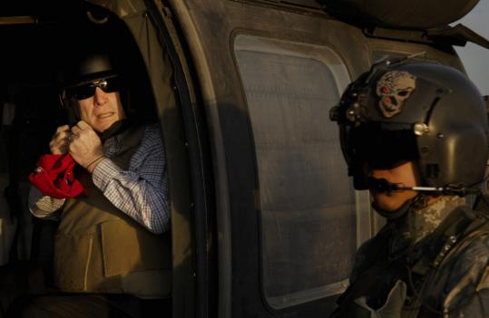 John McCain prepared to take off yesterday in an Army Blackhawk helicopter at Sather Air Base at Baghdad International Airport in Iraq. It was the Arizona senator's eighth trip to the country.