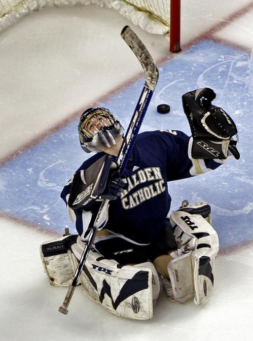 Malden Catholic goalie John Carbonneau looks for divine intervention, but it won't help, as he reacts to allowing a shot from outside the blue line by Reading's Rob Toczylowski (not pictured) to elude him, giving the Rockets a 2-0 second-period lead.