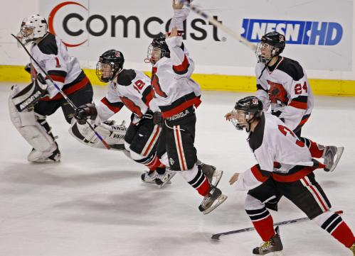 Reading players skate off the bench to celebrate the Rockets' win over Malden Catholic.