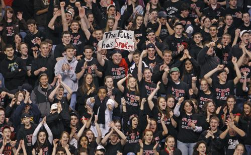 Reading fans (including one holding a sign that reads 'The Public Has Spoken' celebrate after they defeated Malden Catholic, 3-0.