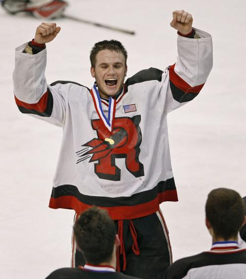 Reading's Quinlan Junta rejoices after receiving his championship medal.