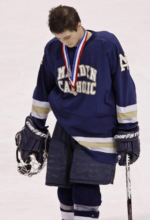 Malden Catholic's Craig Carbonneau can't hide his disappointment after receiving his runner-up medal.