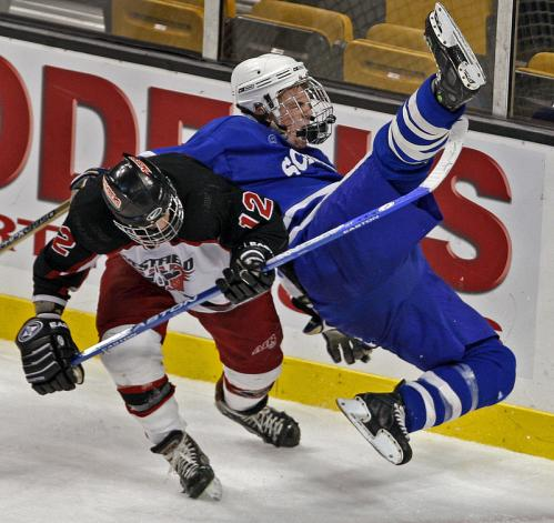 Scituate's Pat Mahoney (right) is upended by Westfield's Sean Frere (left) on a third-period hit.