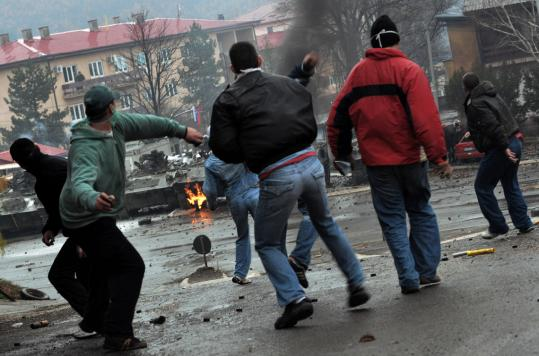 Kosovo Serbs battled soldiers yesterday in the ethnically divided town of Kosovska Mitrovica. At least one UN vehicle and one NATO truck were set ablaze.