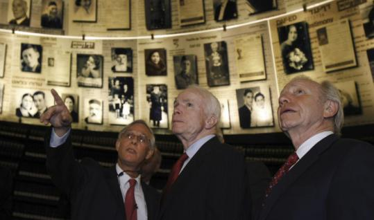 Senators John McCain (center) and Joseph I. Lieberman yesterday listened to Ephraim Kaye, director of the International School for Holocaust Studies, during a visit to the Yad Vashem Holocaust memorial in Jerusalem.