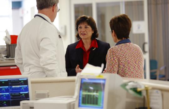Emerson Hospital chief Christine Schuster (center) said former employees manipulated the hospital's earnings by misusing contractual allowances - the discounts hospitals give insurance companies on the 'official' prices for services and procedures.