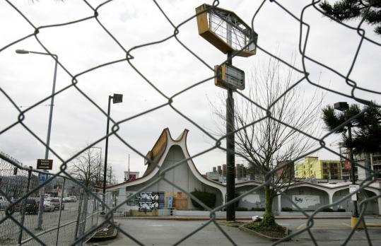 A boarded-up former Denny's restaurant has been designated as a landmark by Seattle's Landmarks Preservation Board, blocking construction of a condominium building on the site.