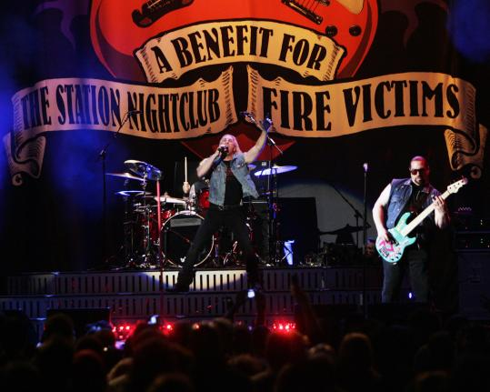 Dee Snider (center) performs with Twisted Sister last month during a benefit concert at the Dunkin' Donuts Center in Providence. In VH1's 'Aftermath,' concert footage is interspersed with stories from survivors of the Station nightclub fire.