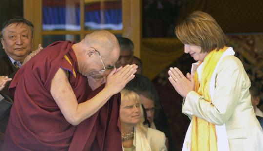 The Dalai Lama and House Speaker Nancy Pelosi greeted each other yesterday in Dharmsala, India, seat of the Dalai Lama's government-in-exile.