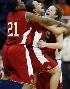 Hartford's MaryLynne Schaefer (right) rejoices with Jonyce Hollins (left) and Courtney Gomez.