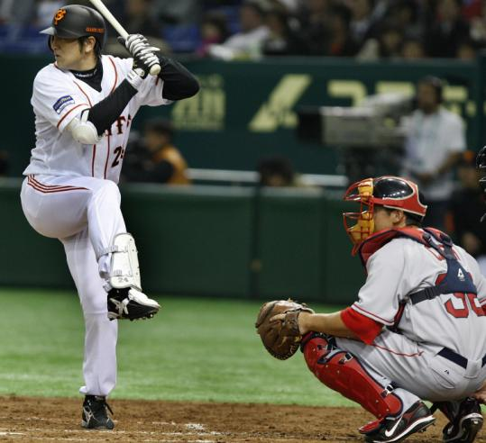 Yomiuri's Yoshinobu Takahashi shows off his rather unusual batting stance during yesterday's exhibition game.