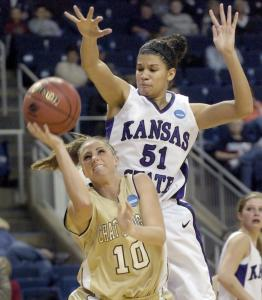 Kansas State's Shalee Lehning is a towering presence as she prepares to block this shot by Chattanooga's Laura Hall.