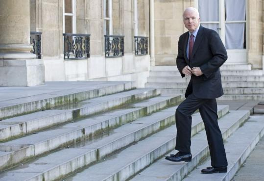Senator John McCain, the presumptive Republican presidential nominee, entered Élysée Palace in Paris Friday to meet President Nicolas Sarkozy. Recent polls favor his stance on the Iraq war.