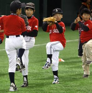 The Red Sox held a clinic for Japanese youth league players yesterday; budding Daisuke Matsuzakas apply the lessons.