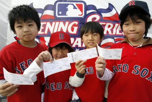 Red Sox fans show off their tickets for today's season opening game against the Oakland Athletics at the Tokyo Dome.