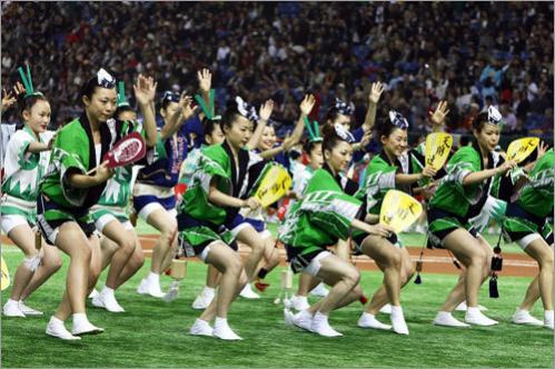 Dancers perform during the opening ceremony during the opening series between the Red Sox and Athletics at the Tokyo Dome.