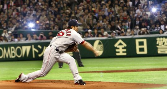 Despite the flashbulbs that recorded his Japanese debut with the Red Sox, it wasn't a lights-out first inning for Daisuke Matsuzaka, who allowed two runs.