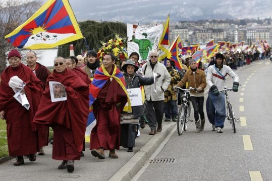 During a march yesterday in Geneva, monks and pro-Tibetan activists denounced what they believe is a reluctance by the UN to speak against China's use of force in Tibet.