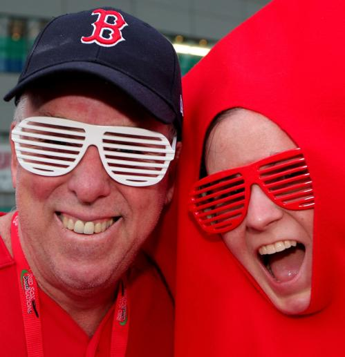 Red Sox fans pose outside the Tokyo Dome.