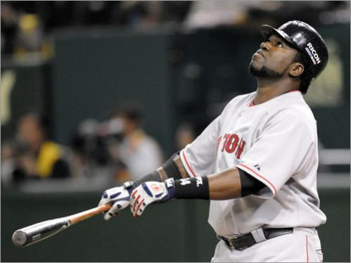 Sox slugger David Ortiz watches a foul ball fly off his bat.