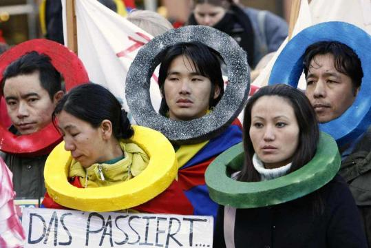 Tibetan exiles wearing Olympic rings attended a Free Tibet demonstration in Hamburg yesterday. China's crackdown in Tibet has brought international protest and frustration for a Communist leadership that had hoped for a smooth run-up to the Games.