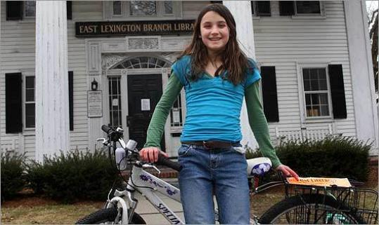 Geneva Kropper, 12, started a campaign to preserve the East Lexington Branch Library at the Stone Building. Local leaders are considering other uses for the building, which was closed after a water pipe burst in August.