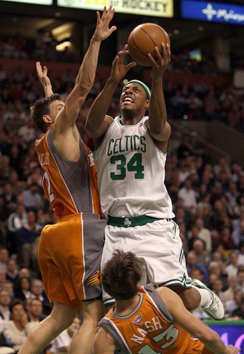 Paul Pierce (34) plows through Steve Nash (13) and Gordan Giricek (2) while trying to get to the rim.