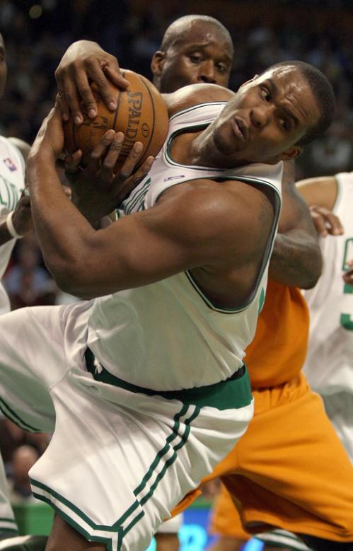 Boston's Glen Davis (11) grabs the rebound from Shaquille O'Neal.