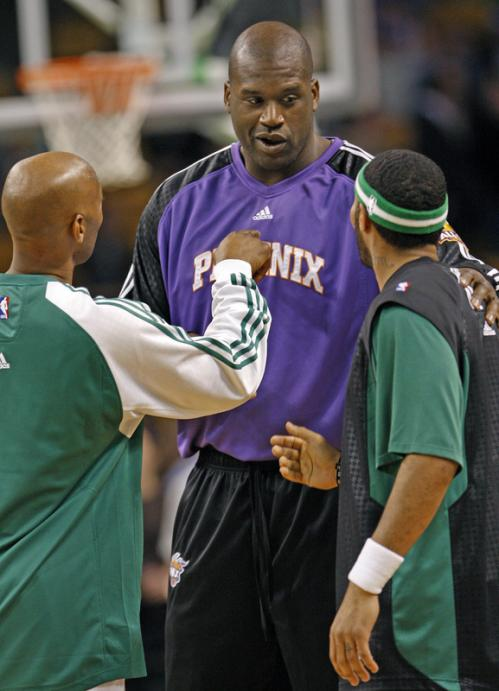 Three players that have all switched teams since last year, Sam Cassell, left, Shaquille O'Neal, center, and Eddie House chat before the game.