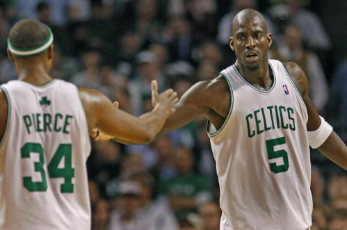 Paul Pierce (left) and Kevin Garnett celebrate after a fourth-quarter basket.