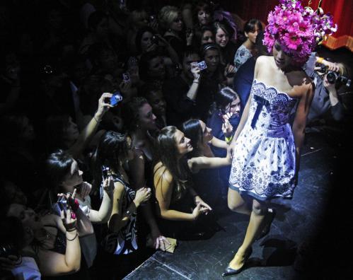 A flowery Melissa Jones posed on stage.