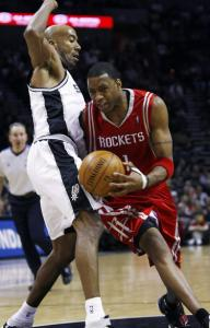 Bruce Bowen (left) was able to keep the Rockets' Tracy McGrady on uncertain footing.