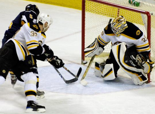 Buffalo's Toni Lydman (left) first beat Zdeno Chara with his skates and then beat goalie Alex Auld with the puck.