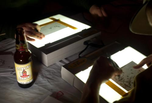 A promotional prop — also known as a beer bottle with a customized label — designed by event organizer and promoter Lenny Boudreau sits by a light table. More Hot Shots More info on Paddy O's SUBMIT Your nightlife photos! TALK What scene should we visit next?