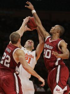 Dan Werner is well-covered by UMass's Etienne Brower (22) and Dante Milligan (17 points, 12 rebounds) in the second half.