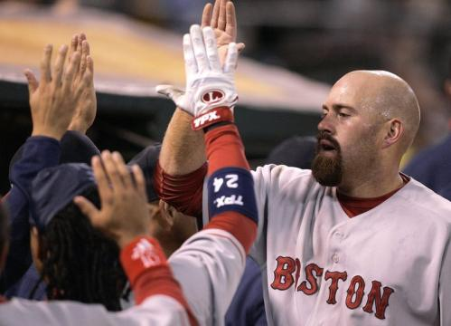 Youkilis (right) was congratulated as he entered the dugout after scoring in the fifth inning.