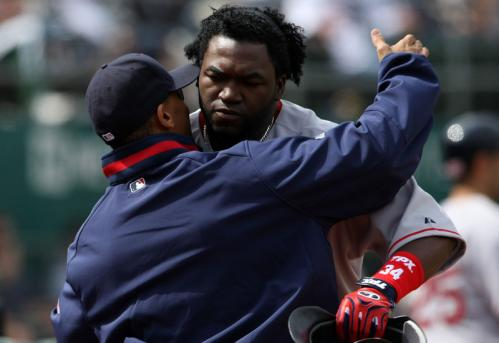 David Ortiz is hugged by a teammate after hitting a two-run home run during the sixth inning.