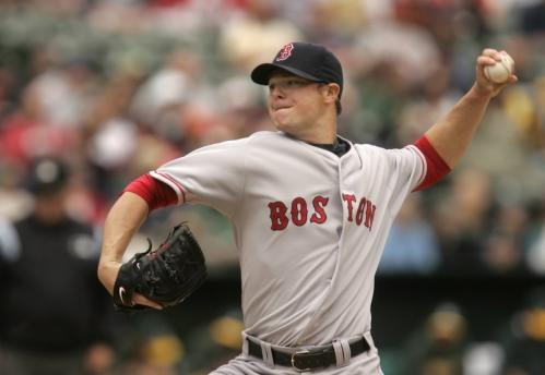 Jon Lester throws a pitch in the first inning against Athletics during the Red Sox 5-0 win.