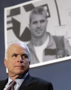 John McCain, framed yesterday at a rally in Pensacola, Fla., by a photo of himself in his 20s, says he wants access to healthcare for all citizens while also diminishing the government's role.