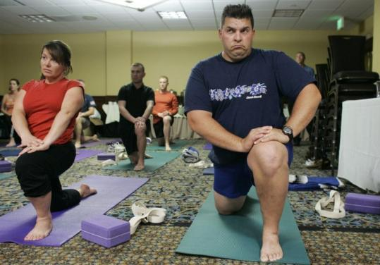 Aaron Seibert, who was wounded in Iraq, and his wife, Robin, practiced yoga during a Warrior Couple Readjustment Retreat.
