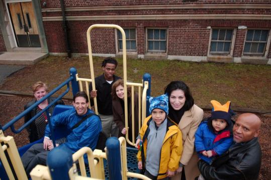 Donna Sullivan of the Oak Square YMCA, Tom O'Brien of the Presentation School Foundation, Marvin Neal of Little Sprouts, Jeanne Hopkins of WGBH, and Priscilla and Marcelino Cardoso of the foundation, with sons Lucas (left) and Lucio. The group is working on plans for a preschool.