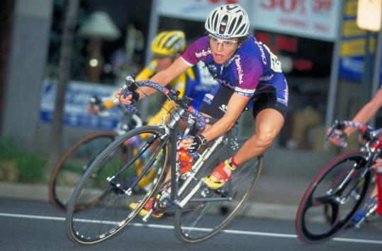 Nicole Freedman, Boston's top bicycling official, pedals through Arlington, Va., in a 2000 contest.