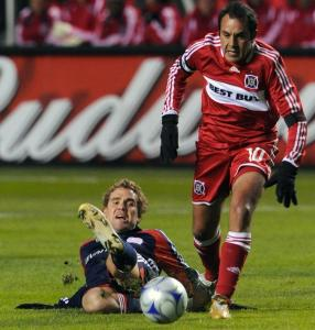 Chicago's Cuauhtemoc Blanco stands tall during a battle for the ball with Chris Albright.